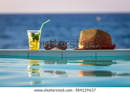 Summer Vacation - Cocktail, Glasses and Hat - stock photo