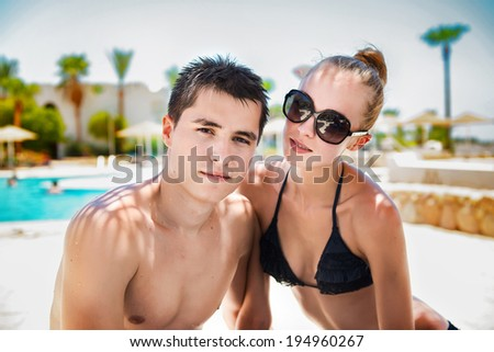 Summer vacation couple on sunny day in tropical resort - stock photo
