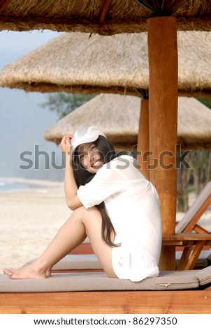 summer vacation - happy young woman at the tropical beach - stock photo