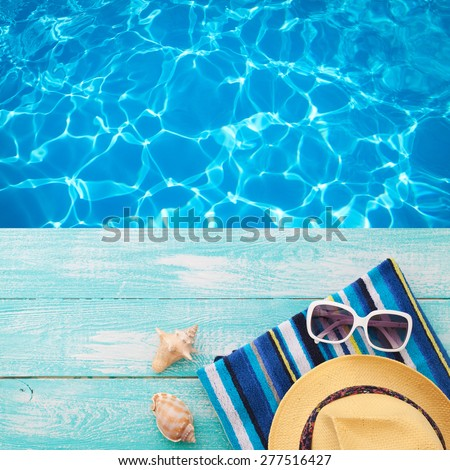 Summer vacation. Pink sandals by swimming pool. Blue sea surface with waves, texture water. Flat mock up for design. - stock photo