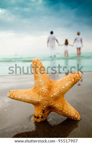 Summer vacation - portrait of  family at the beach - stock photo