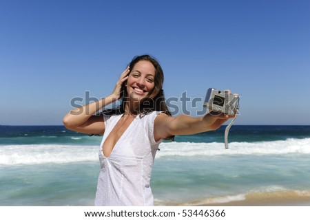 summer vacation: woman taking a photo with a digital compact camera - stock photo