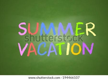 Summer vacation written in chalk on a chalkboard - stock photo