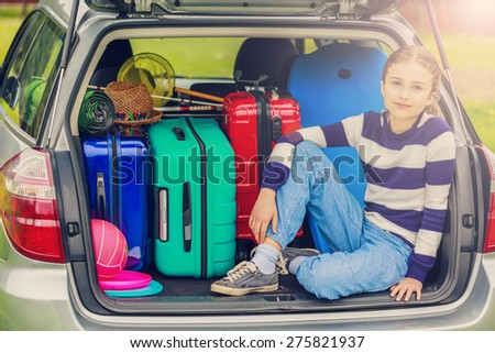 Summer vacation, young girl ready for travel for family vacation-filtered  - stock photo