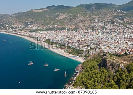 Summer vacations - blue Mediterranean sea and Cleopatra sand beach resort of Turkey Alanya view from ancient mountain castle wall - stock photo