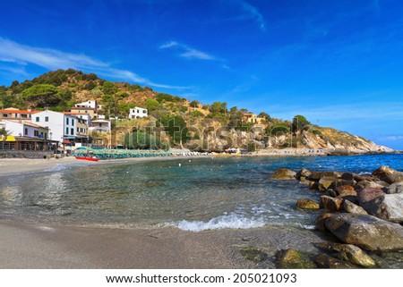 summer view of Saint Andrea village with the sandy beach, Elba island, Italy - stock photo