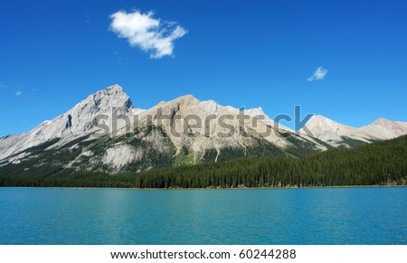 Summer view of the beautiful blue maligne lake and surrounding rocky mountains in jasper national park, alberta, canada - stock photo