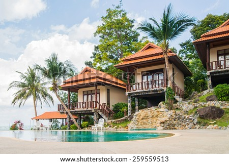 Summer villa with a swimming pool on the beach.  - stock photo