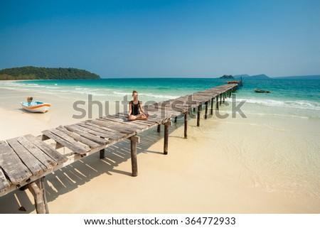 Summer yoga session on a beach - tropical Koh Rong island, Cambodia. Meditation - lotus pose -  - stock photo