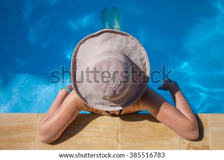 summertime fun, relaxing in a pool on a hot sunny day - stock photo