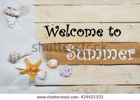 Summertime image with beach theme of clean white sand scattered on boardwalk planks with starfish and seashells making a side border. Summer message added. Plenty of texture. Horizontal composition. - stock photo