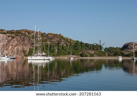 Summertime in sweden. Boats in a lagoon. - stock photo