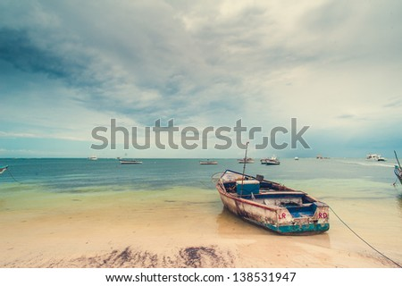 summertime. Tropical life. tropical panoramic beach. Dominican Republic. native typical tropical island. caribbean life. boat on the beach - stock photo