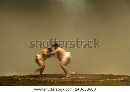 Sumo Wrestlers in Ring - stock photo