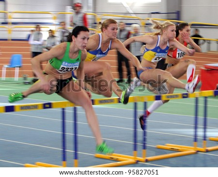 SUMY,UKRAINE-FEB.16:(L-R)Melnychenko Hanna, Dobrynska Natallia - Olympic Champion in Beijing, Mohnuk Anastasia, Romanuk Oksana on the Ukainian T & F Championships on February 16, 2012 in Sumy, Ukraine - stock photo
