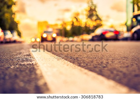 Sun after the rain in the city, view of the approaching car with the level dividing line. Image in the yellow-purple toning - stock photo