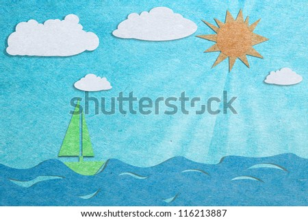 sun and blue sea recycled paper craft background - stock photo