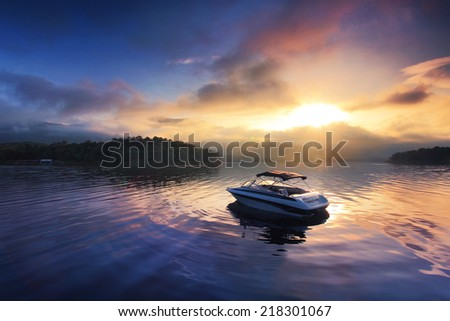 Sun and mist on a Summer , boat dock at sunrise - stock photo