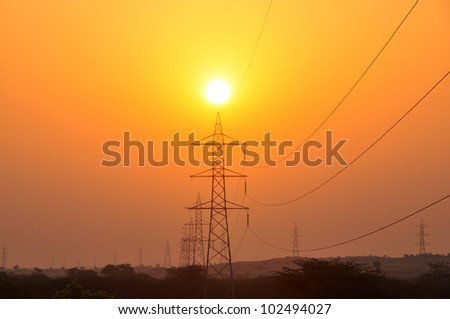 Sun and power lines - stock photo