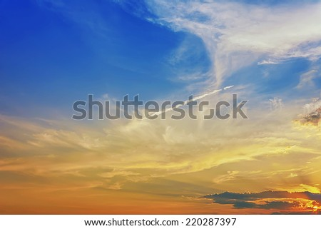 Sun at sunrise / sunset with clouds and blue sky - stock photo