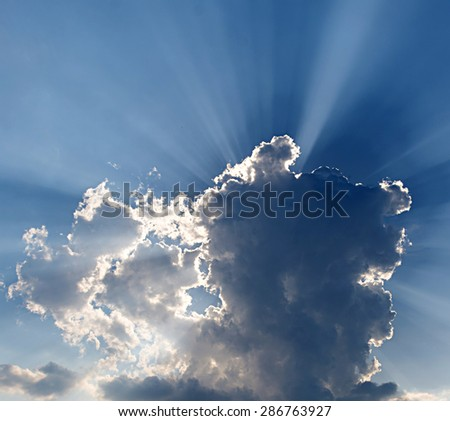 Sun beam through the clouds. - stock photo