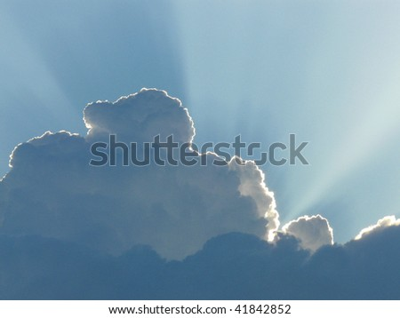 Sun behind the clouds - stock photo