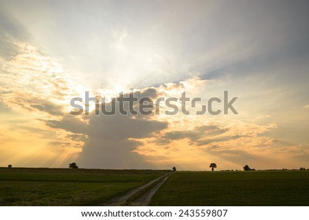sun behind the clouds on a warm day, nature series - stock photo