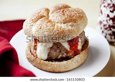 Sun Dried Tomato Pesto & Mozzarella Turkey Burgers - stock photo