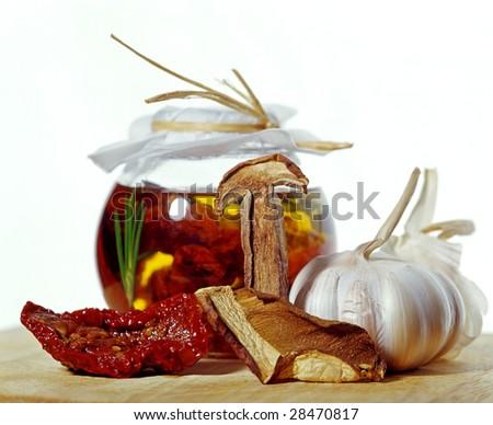 sun dried tomatoes and garlic - stock photo