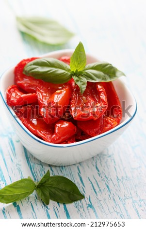 sun-dried tomatoes with garlic herbs and spices - stock photo