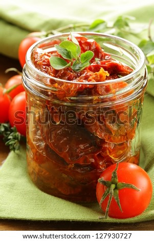sun-dried tomatoes with herbs and olive oil - stock photo