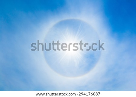 Sun halo in the sky. The sun halo is circle around the sun or the moon made from ice crystals in the sky. It is rare phenomenon - stock photo