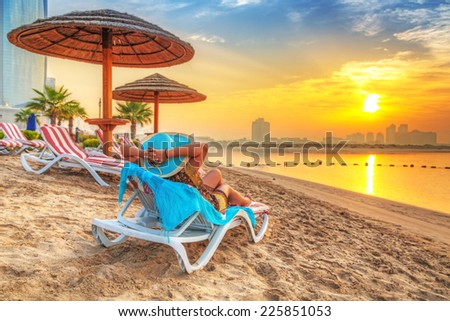 Sun holidays on the beach of Persian Gulf - stock photo