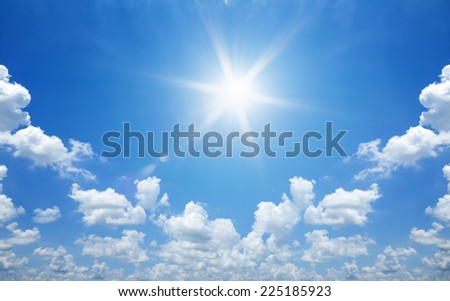 Sun in bright blue sky. - stock photo