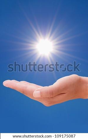 Sun in hand - stock photo