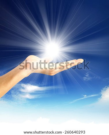 Sun in hands - stock photo