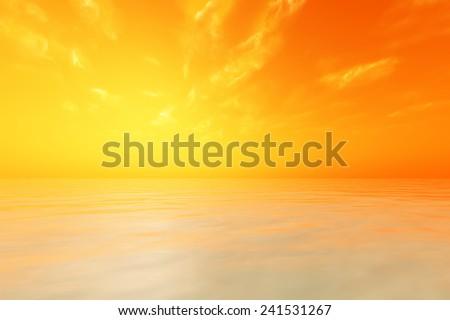 sun in orange sky over calm sea - stock photo