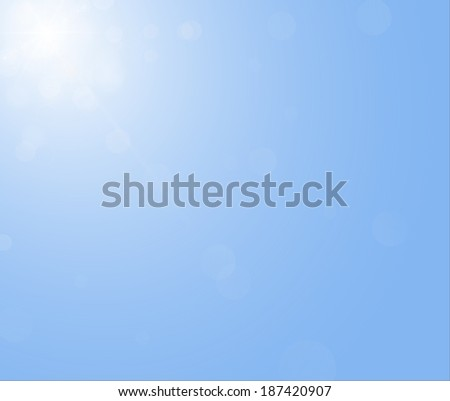 Sun is shining on the blue sky without clouds. Illustration of the sunbeam. - stock photo