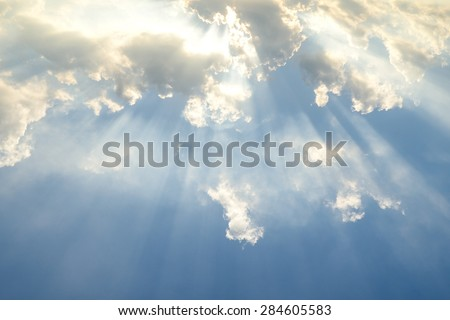 Sun light shining through the clouds - stock photo