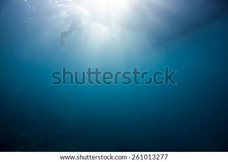 sun light through the water surface - stock photo