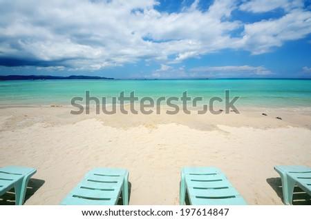 Sun lounger on a tropical beach - stock photo