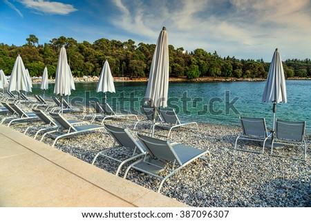 Sun loungers and beach umbrellas on the beach,Rovinj,Istria region,Croatia,Europe  - stock photo