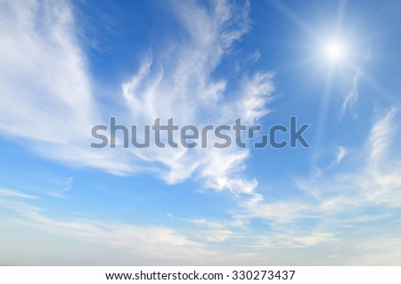 sun on blue sky with white clouds - stock photo
