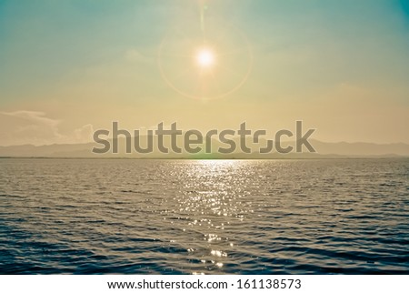 Sun on the river - stock photo