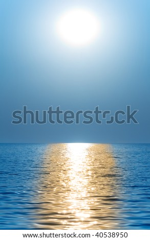 Sun or moon above the waves of the sea or ocean - stock photo