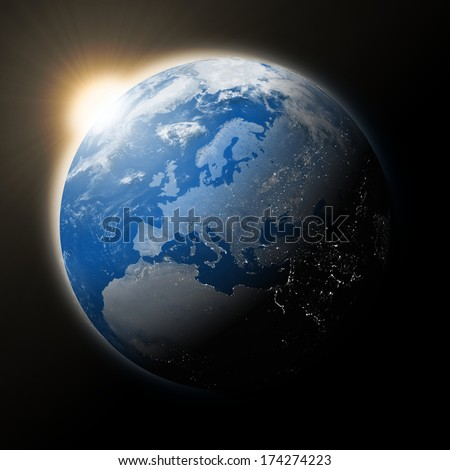 Sun over Europe on blue planet Earth isolated on black background. Elements of this image furnished by NASA. - stock photo