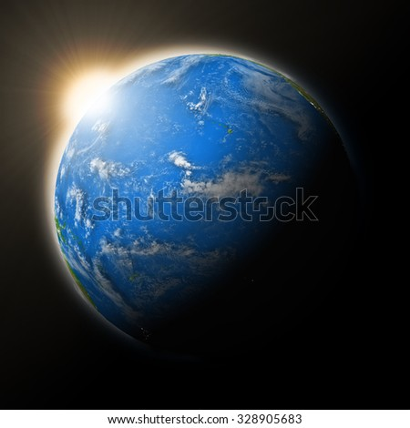 Sun over Pacific Ocean on blue planet Earth isolated on black background. Highly detailed planet surface. Elements of this image furnished by NASA. - stock photo