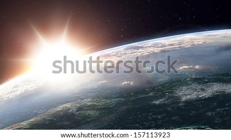 Sun over the horizon - view from orbit.  - stock photo