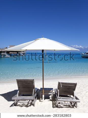 Sun protection umbrellas, beach, sea.  - stock photo