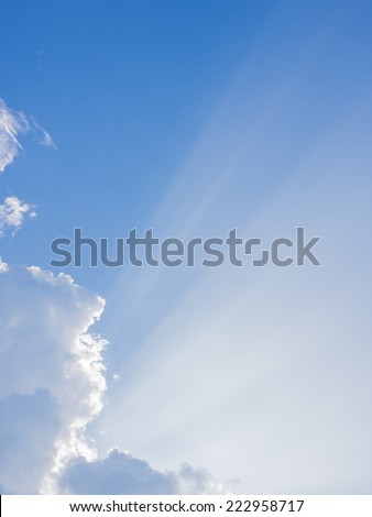 sun rays are striking through the clouds like an explosion - stock photo